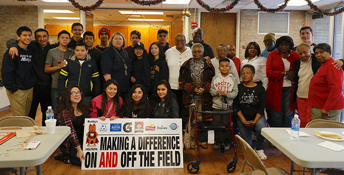 George Washington High School Soccer Players Spread Holiday Cheer At Senior Center